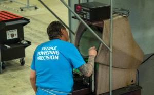 Mitotec Employee Checks Machine